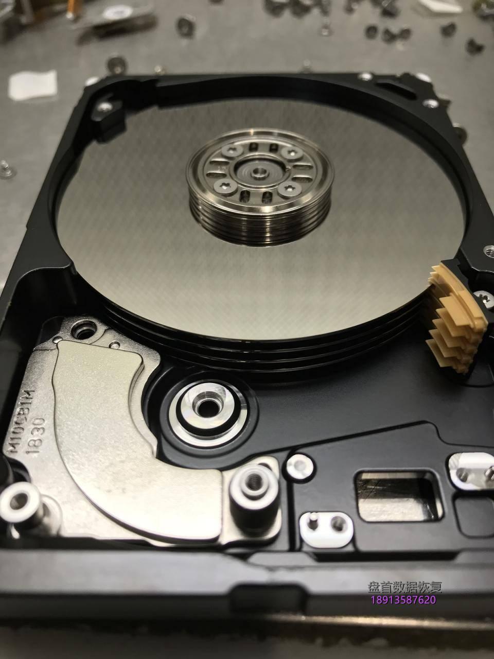 st4000lm024希捷4t移动硬盘摔坏导致磁头变形通电尝试后电-31 ST4000LM024希捷4T移动硬盘摔坏导致磁头变形通电尝试后电机停转,数据恢复成功